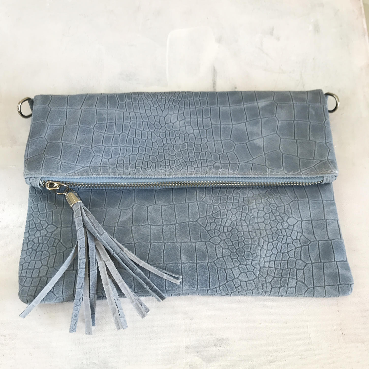Blue tassel clutch bag
