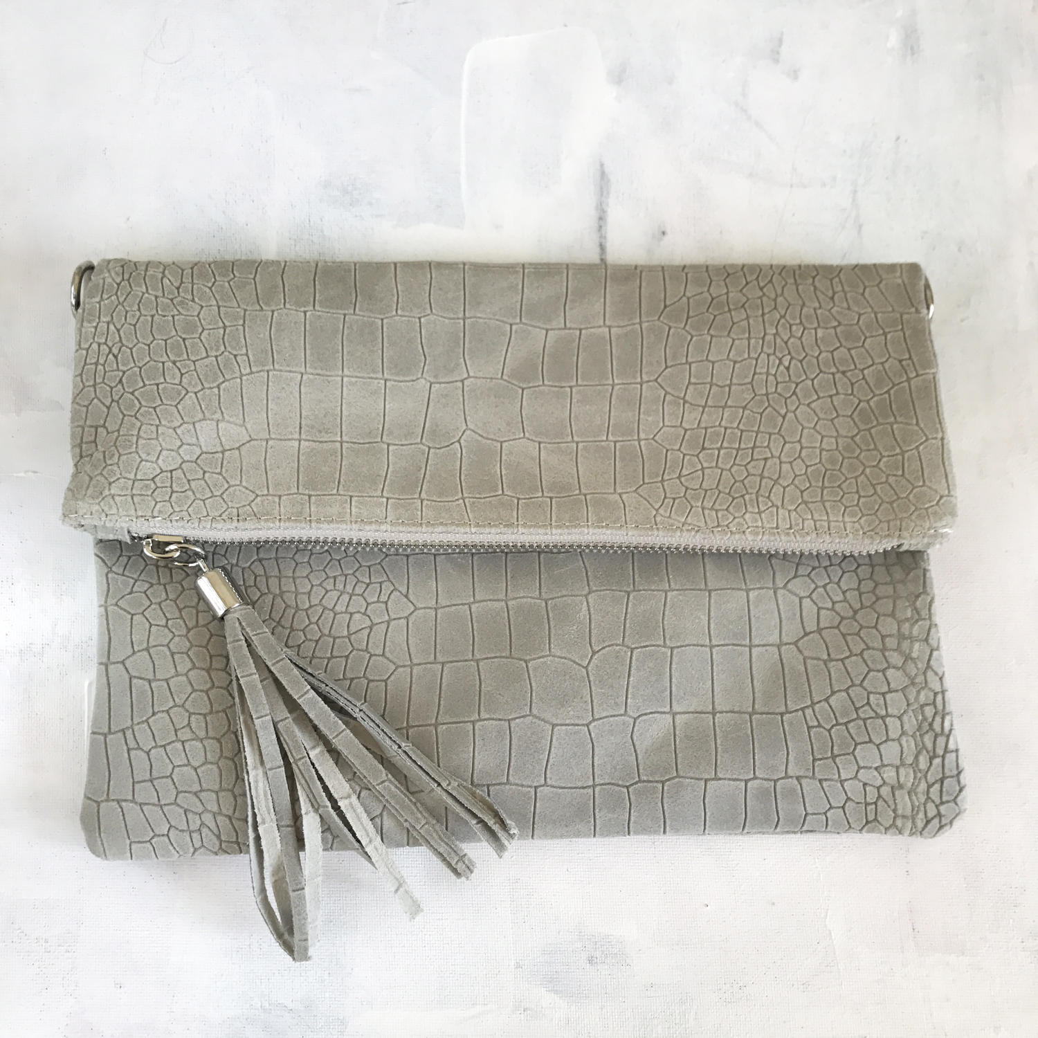 Grey tassel clutch bag