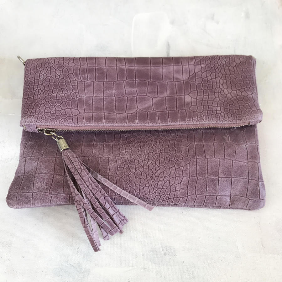 Pink tassel clutch bag