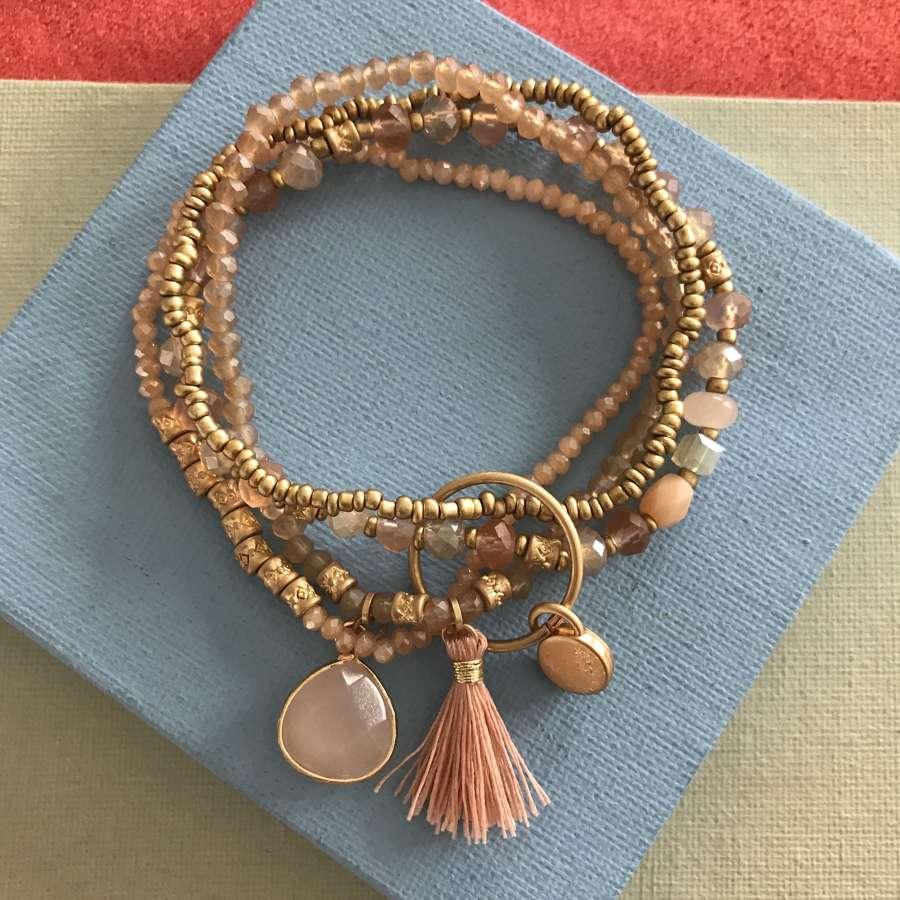 Soft pink tassel bracelet