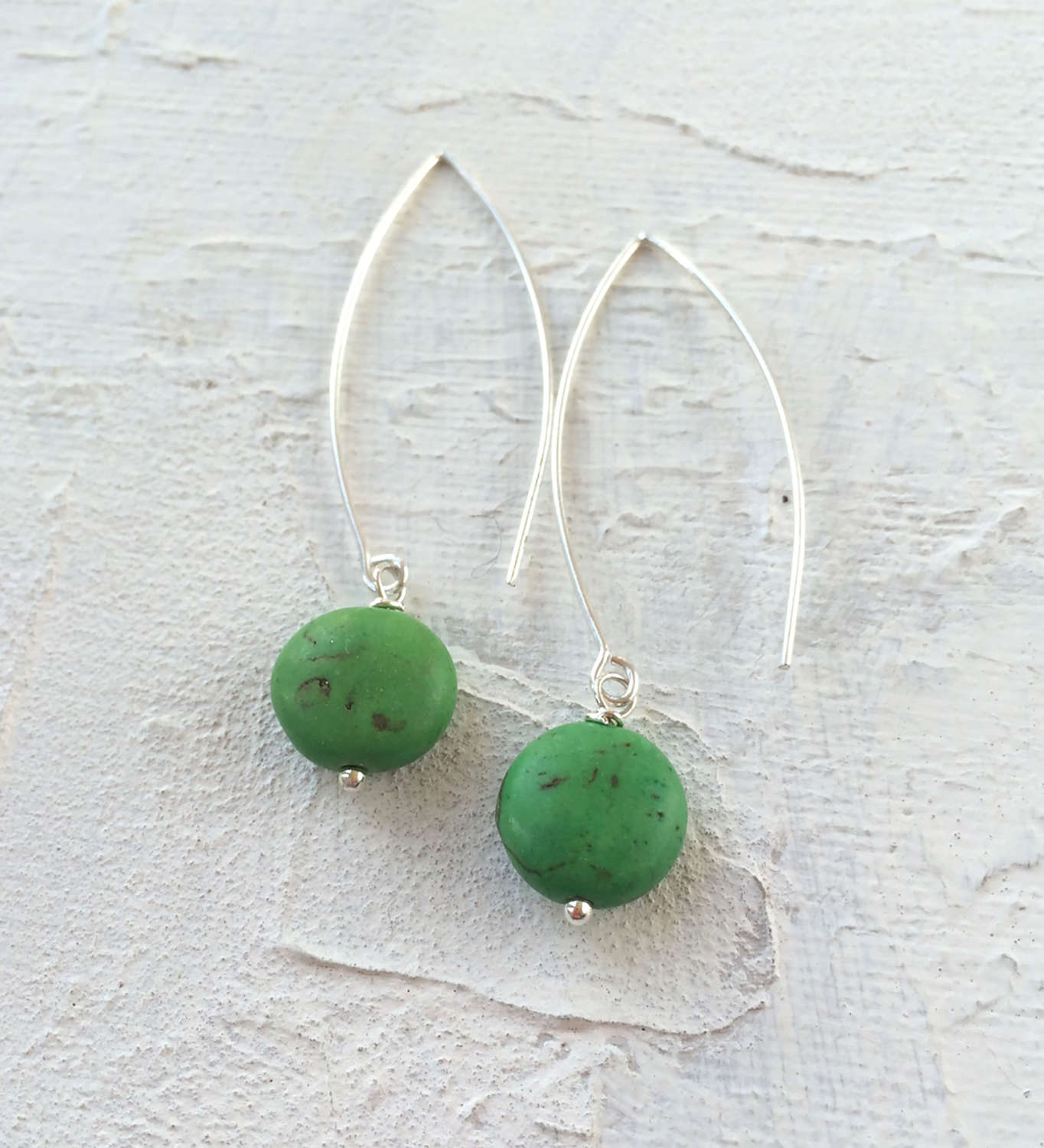 Long drop earrings green