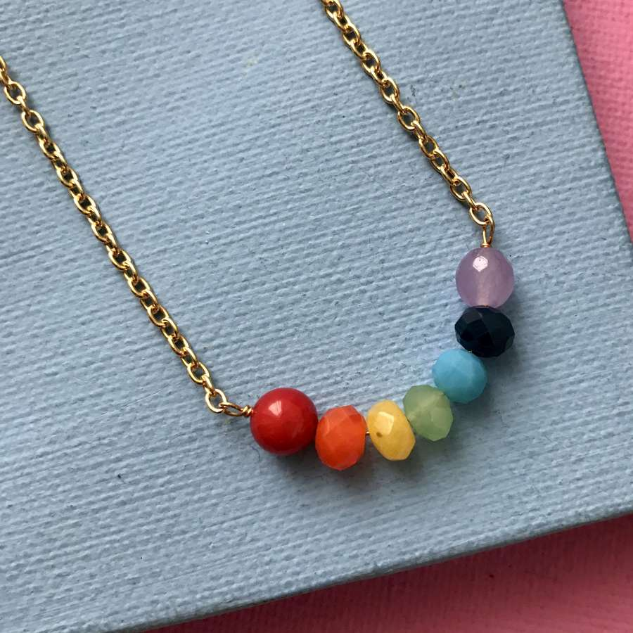 Rainbow smile necklace in gold