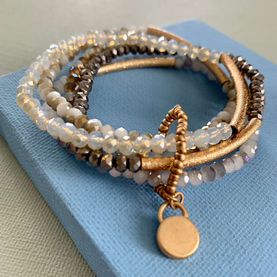 Multi strand grey/gold bracelet