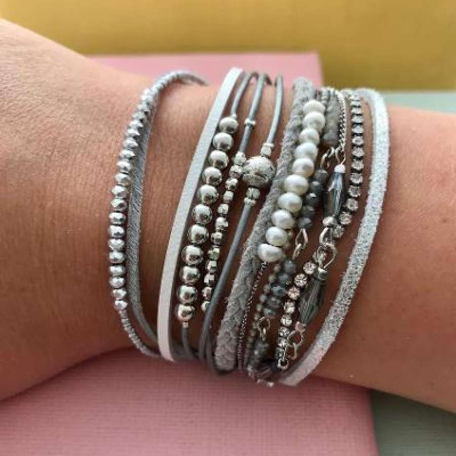 Multi strand bracelet in greys and pearl.