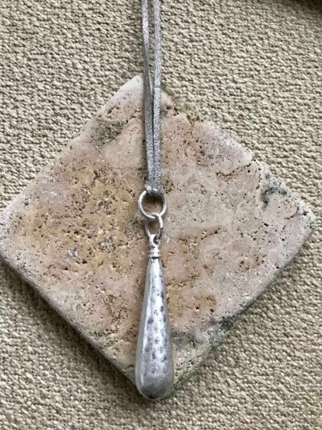 Grey hammered drop necklace