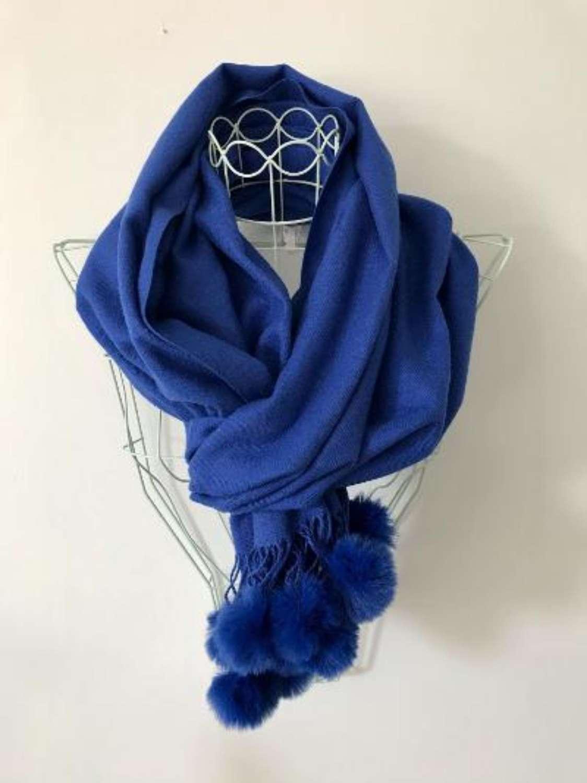 Soft blue scarf with faux fur bobbles