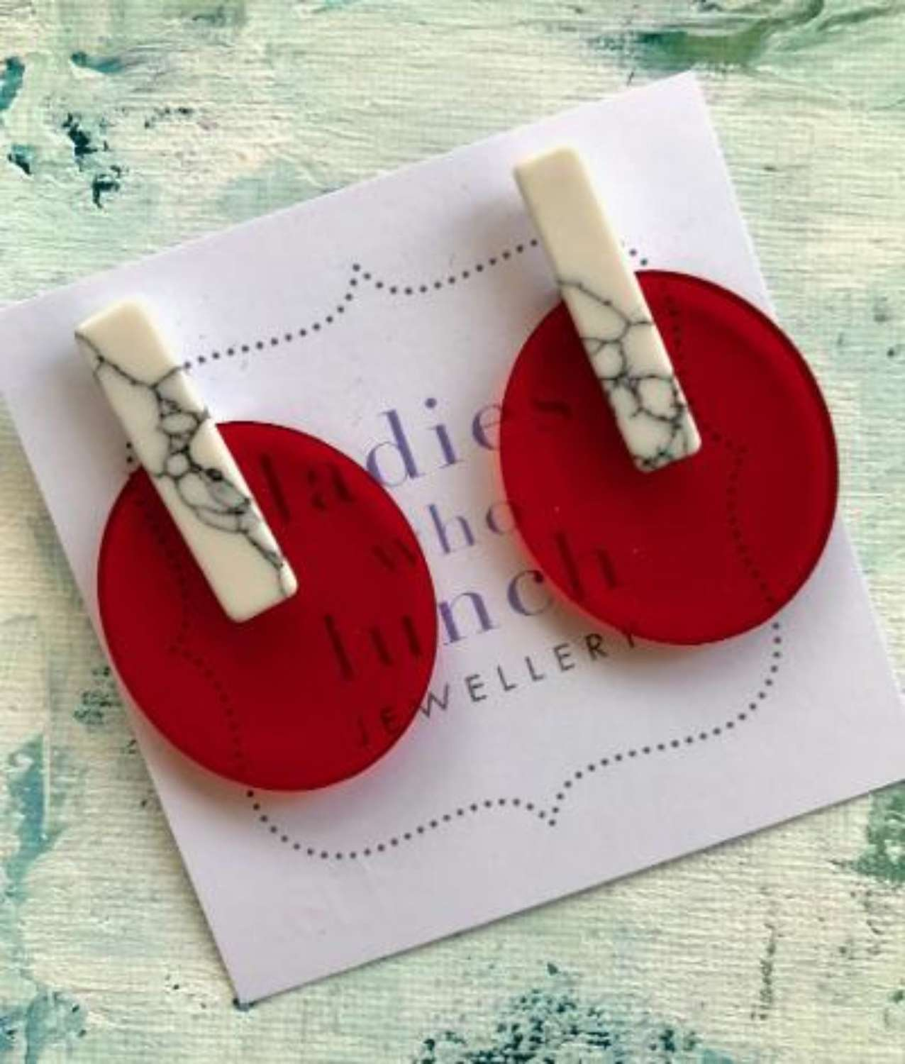 Red and white resin earrings