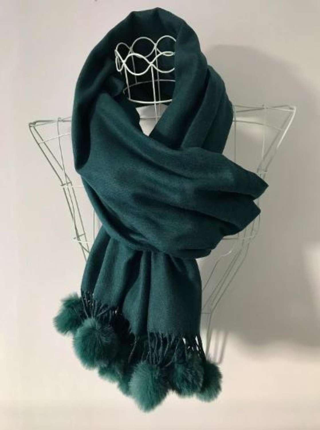 Soft emerald green scarf with faux fur bobbles