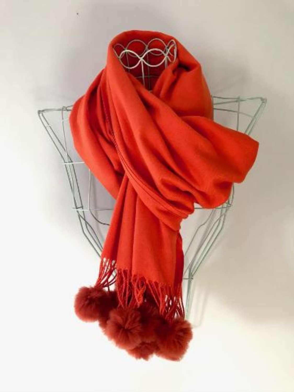 Soft orange scarf with faux fur bobbles
