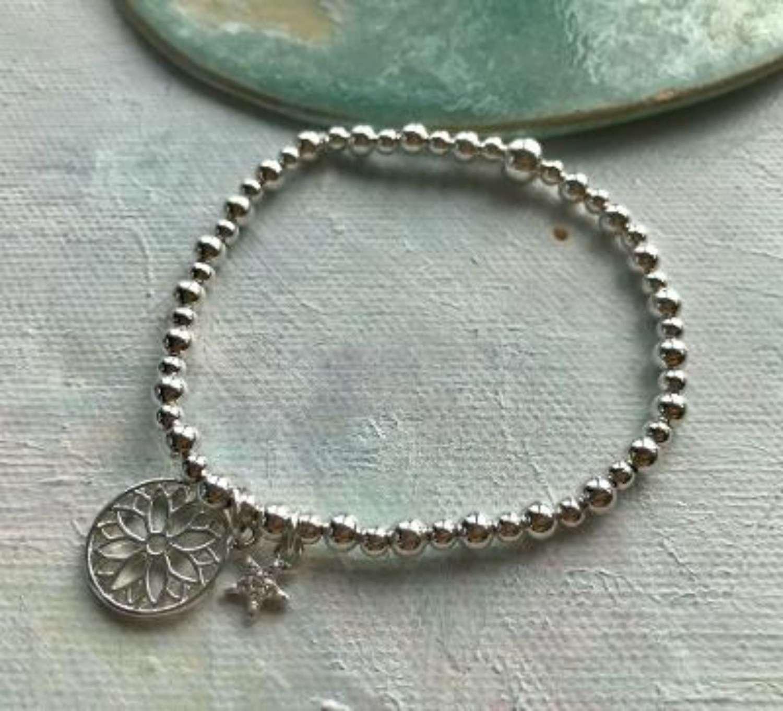 Flower and star bracelet
