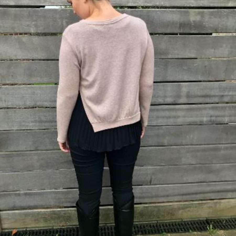 Pale pink jumper with black pleated vest