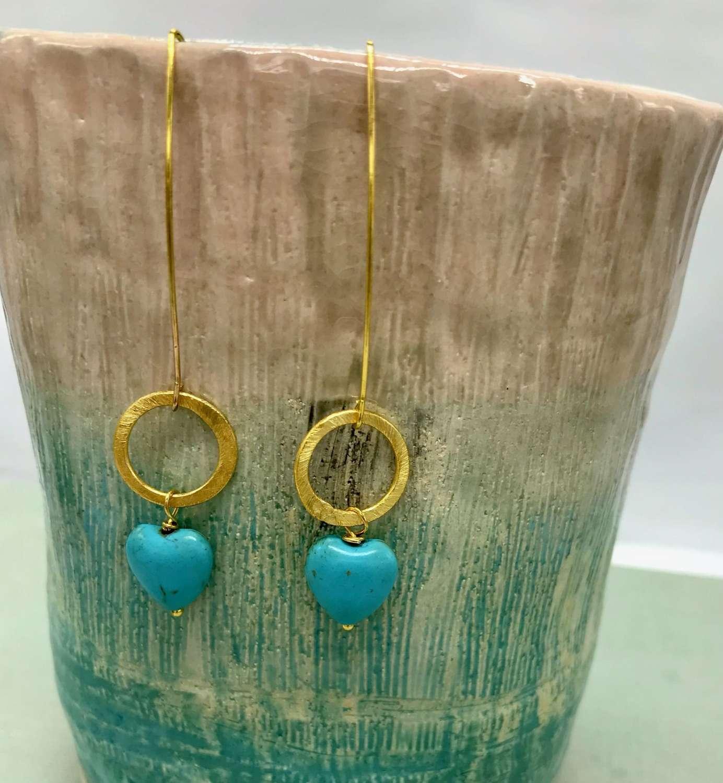 Turquoise heart Freya earrings on gold.