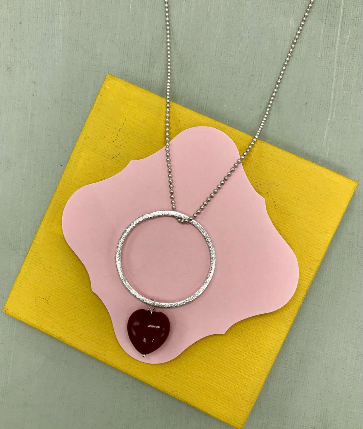 Red heart on circle long pendant
