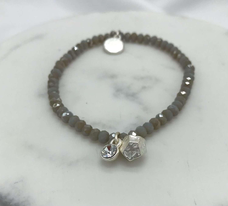 Stretchy grey charm bracelet
