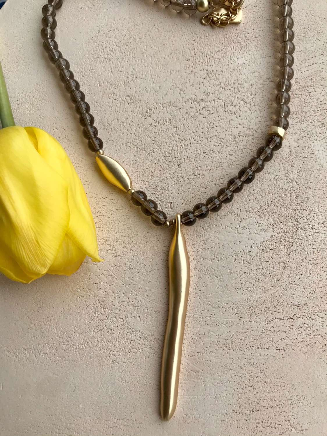 All bronzed necklace