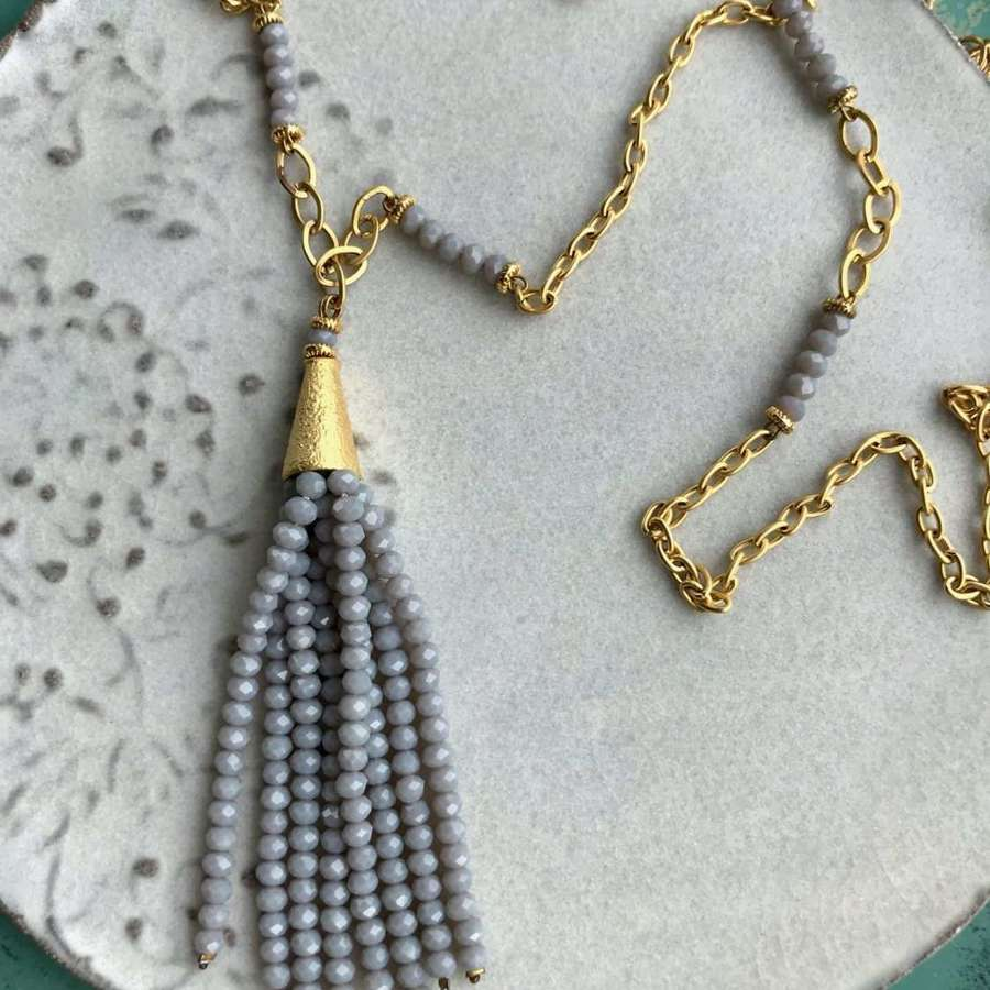 Grey and gold beaded tassel necklace