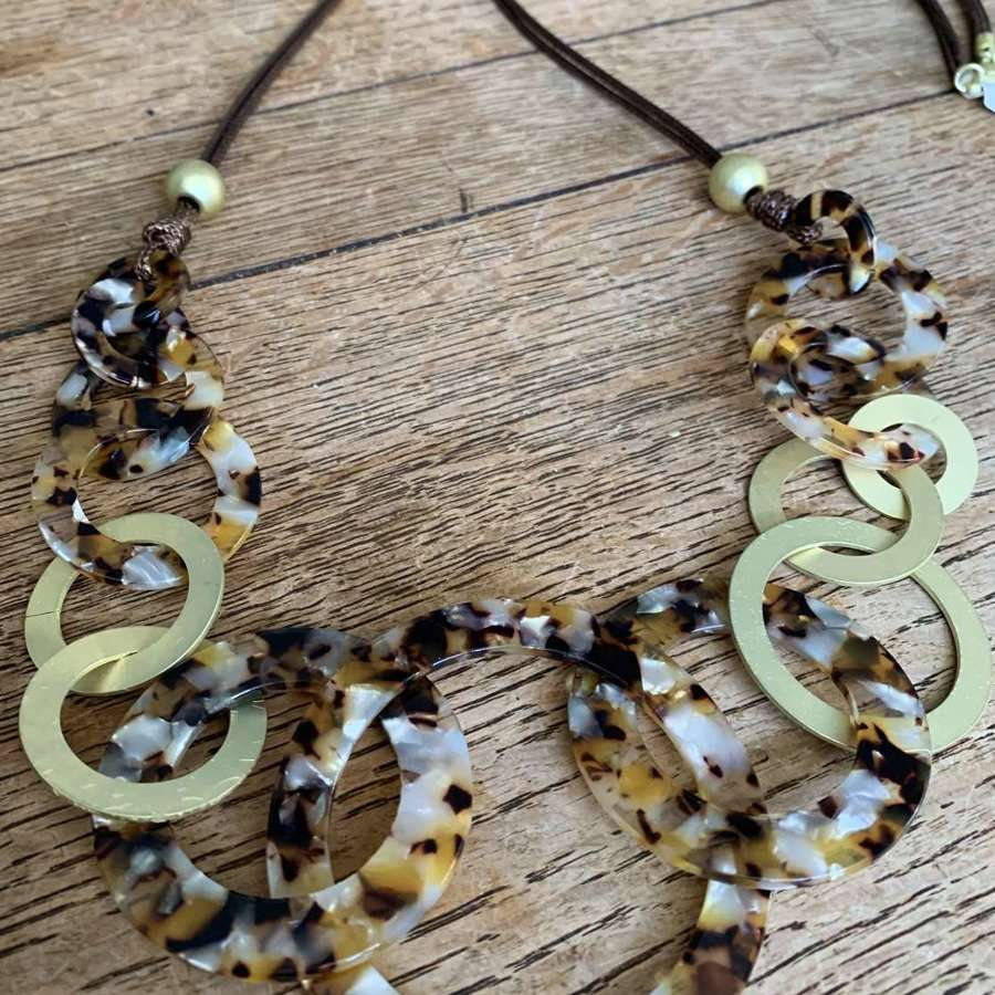 Long animal print and gold circles necklace