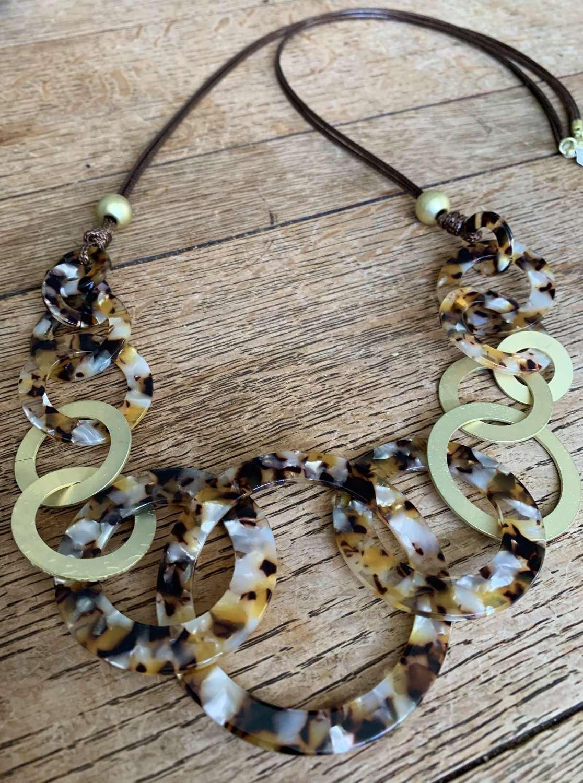 Long animal print and gold circles necklace