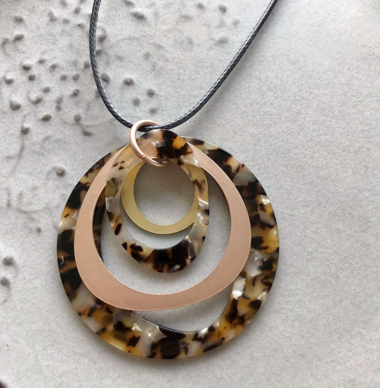 Long animal print, gold and rose gold circle pendant
